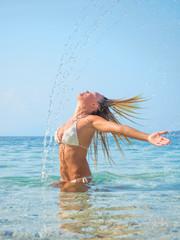 blonde woman  in the water waving hair