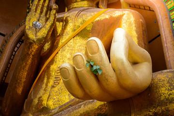 closeup at hand of Gold big buddha statue temple wat tham sua