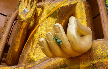 closeup at hand of Gold big buddha statue temple wat tham sua
