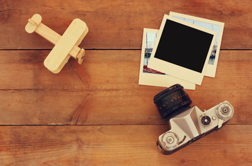 top view image of old blank instant photo, wood aeroplane and old camera
