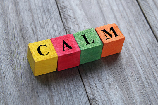 word calm on colorful wooden cubes