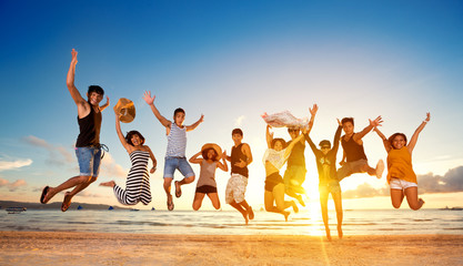 Group of friends jumping on beach