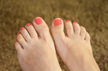 Female feet with painted nails
