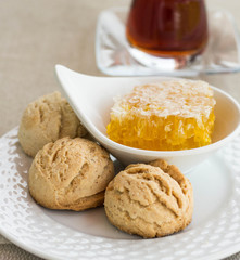 Traditional round shortbread biscuits with honey