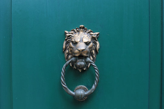Lion head door knocker in Bruges, Belgium
