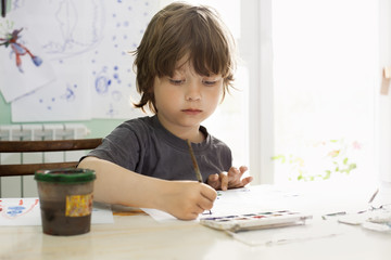 Children draw in home