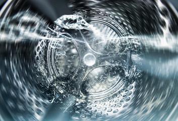 Internal view of an empty washing machine drum during wash