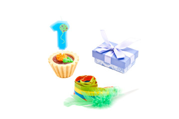 cake with one year birthday candle, whistle and gift