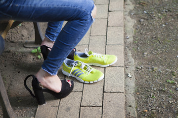 Women are in place to wear sports shoes