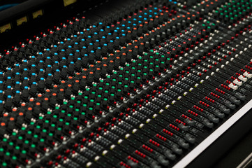 Closeup of a concert sound control board.