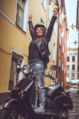 Happy young woman in black leather jacket
