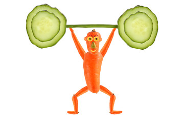 Creative food concept. Funny carrot  raise the bar of cucumber.
