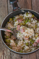 Lemon risotto with bacon and peas top view