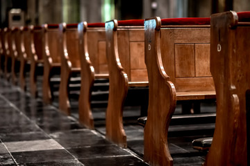 Wooden pews in a row in a church Fotomurales