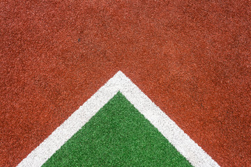 Astro turf sports field lines corners closeup color texture abstract detail.