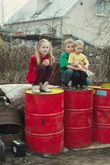 children play at dump drums