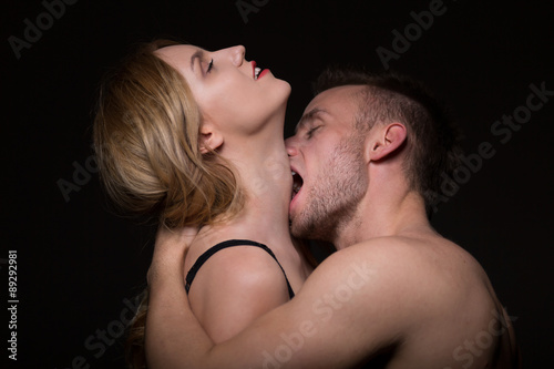 man and woman kissing passionately