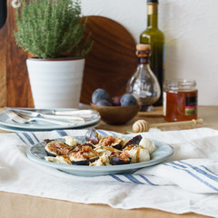 Mozzarella and fresh figs with dressing of balsamic vinegar, olive oil and honey. Selective focus