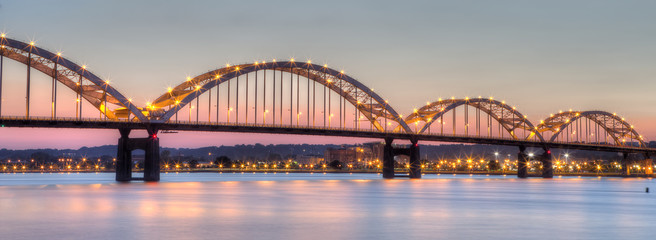 Centennial Bridge across the Mississippi River at dusk between Rock Island, Illinois and Davenport, Iowa