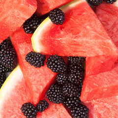 Pieces of watermelon and blackberries