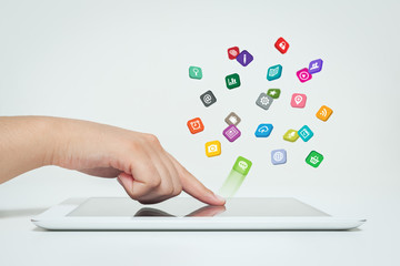 woman touching application icons fly off the tablet computer