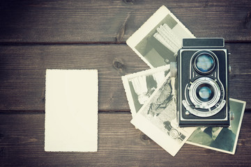 Vintage photo of old camera and old photos