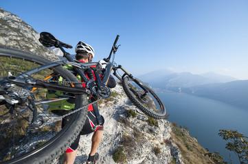 mountainbiker carry his bike - mountainbiking