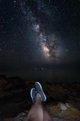 Milky way viewed in first person of the observer with his legs - focus is on the stars the noise is not excessive for this type of picture