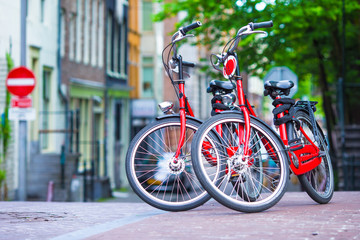 Red Bikes on old bridge in Amsterdam, Netherlands