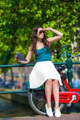 Young beautiful woman on bike in european city