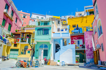 Photo sur Plexiglas Naples italian island procida is famous for its colorful marina, tiny narrow streets and many beaches which all together attract every year crowds of tourists coming from naples - napoli.