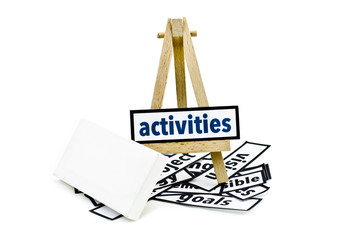 concept activities word on wooden stand.random cutted print paper and empty canvas frame isolated white background