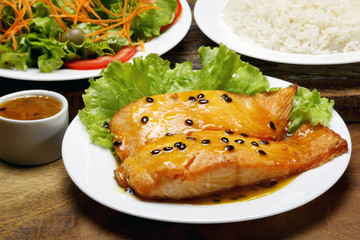 Salmon fillet with rice and salad