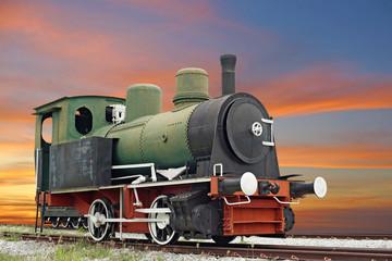 old steam engine locomotive train on beautiful sky background