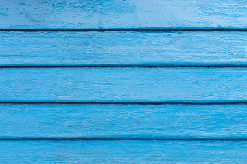 The wooden walls painted blue.