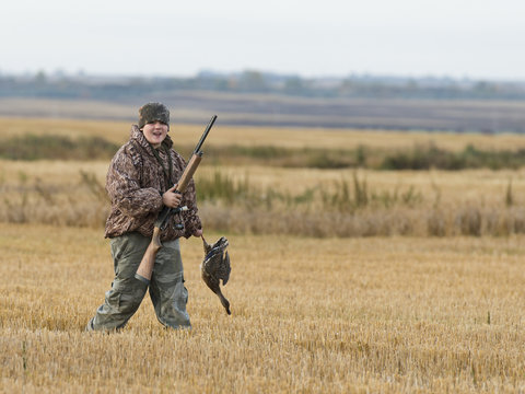 Young Hunter with a duck