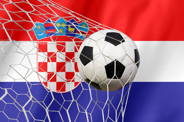 Croatia waving flag and soccer ball in goal net