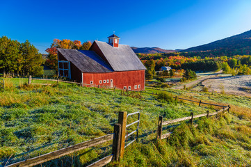 Red barn during a New England fall foliage.