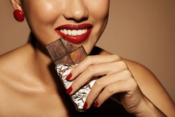 Biting dark chocolate
