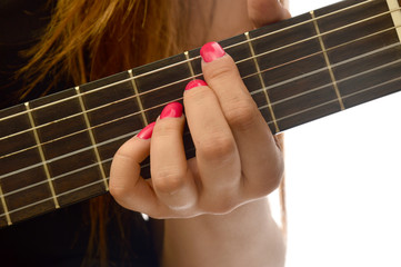 Woman playing a classical guitar