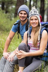Portrait of a young smiling hiker couple