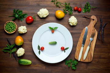 Healthy food. Herbs and vegetables on wooden table with white
