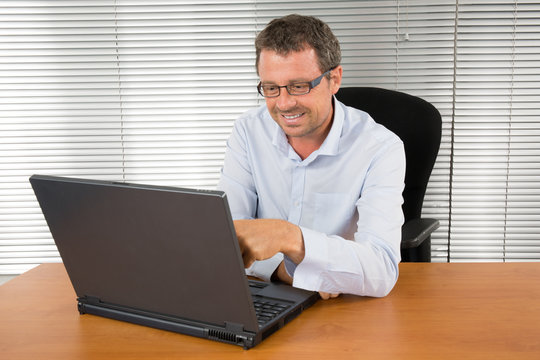 Businessman works on his computer on workplace