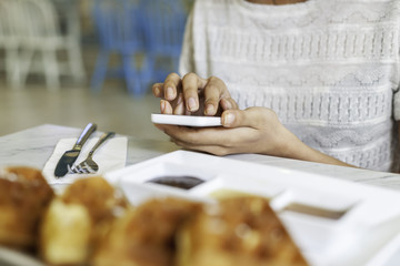 woman using smart phone on the table