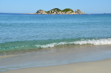 Beach with bright water and distant island