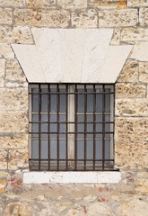 Old window in medieval stone wall