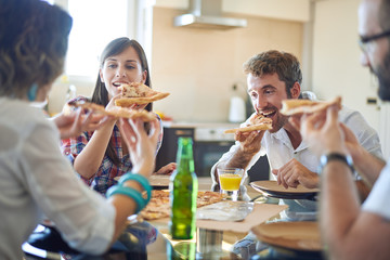 Two couples eating pizza
