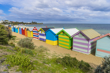 Colourful bathing houses at Dendy Street Beach, Brighton in Melbourne
