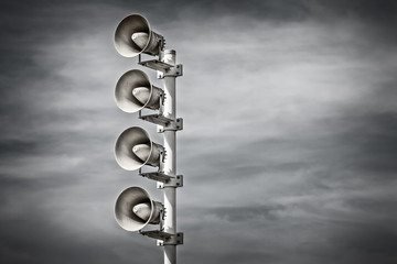 Retro styled image of a row of megaphones