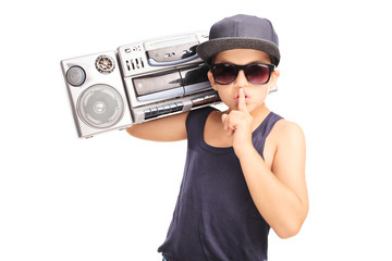 Little boy in hip-hop outfit carrying a ghetto blaster